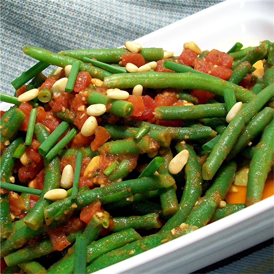 green beans and tomatoes in a white dish