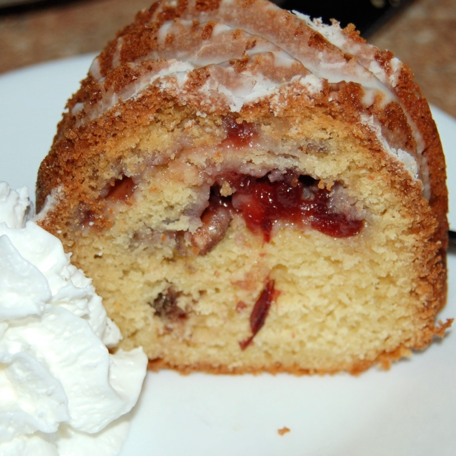 cranberry coffee cake on a white plate
