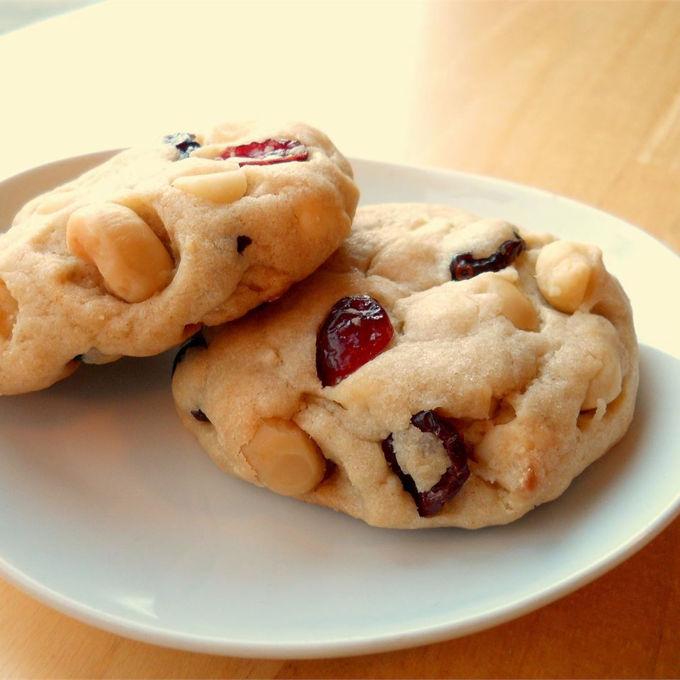 two White Chocolate Macadamia Cranberry Dreams on a plate