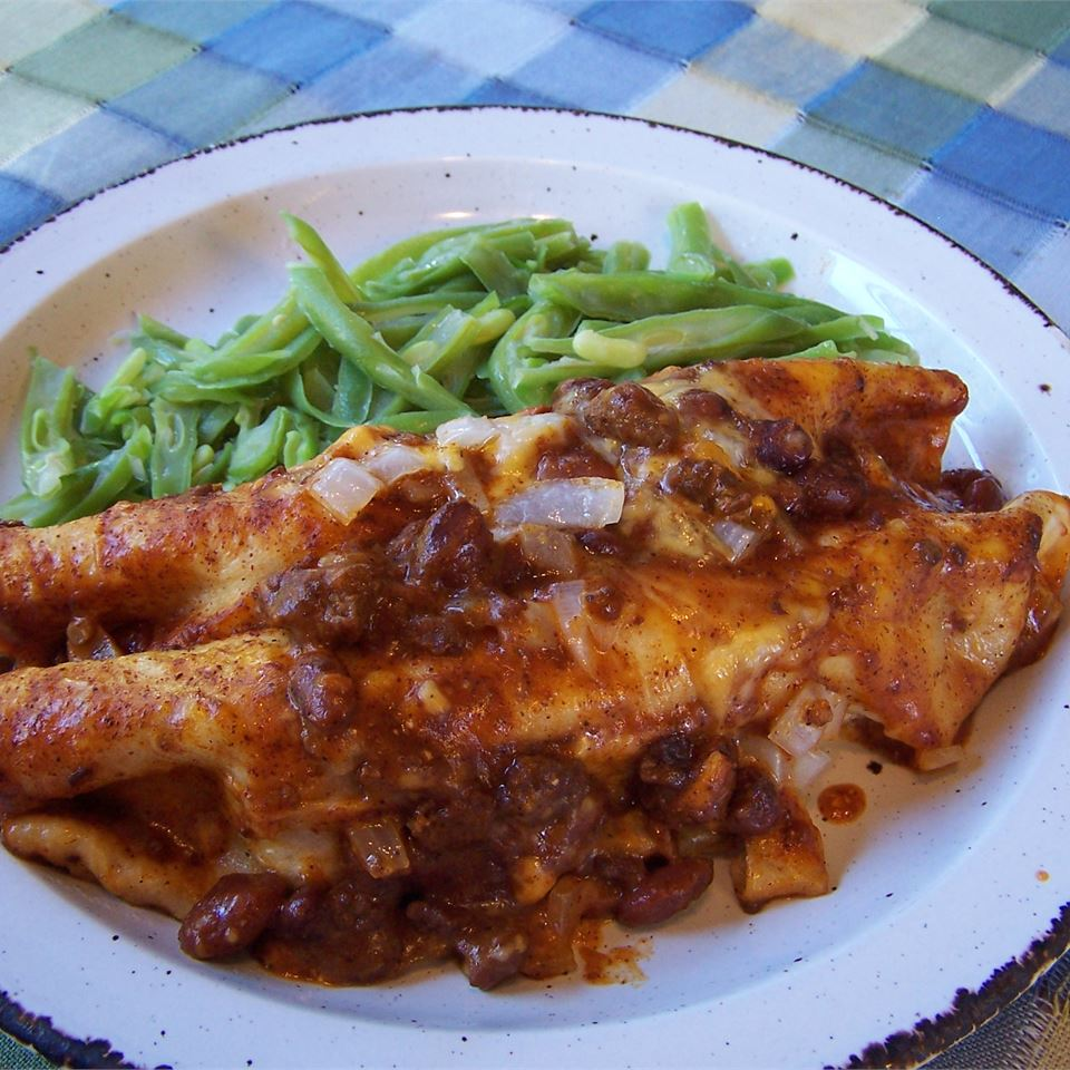 plate of chili dog casserole with green beans on the side