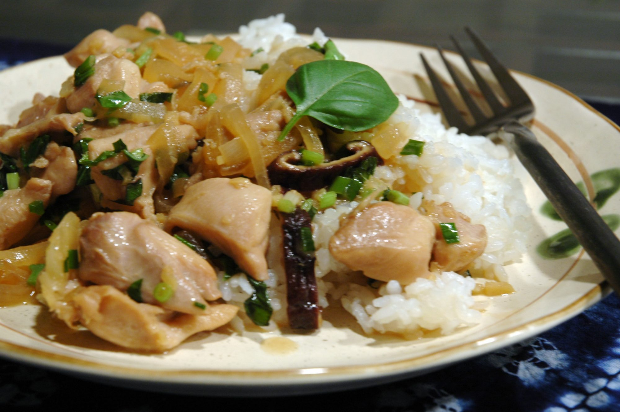 """Chicken strips, mushrooms, onions, ginger, basil, and garlic combine with a coconut milk sauce starring soy sauce, rice wine vinegar, fish sauce, and red pepper flakes. Serve over jasmine rice. """"Absolutely delicious and much better than the chicken basil we get from the local restaurant,"""" says Thanuja. """"I plan on adding more of the coconut milk/vinegar/red pepper flake mixture next time so get more sauce out of it.""""                           Related:"""