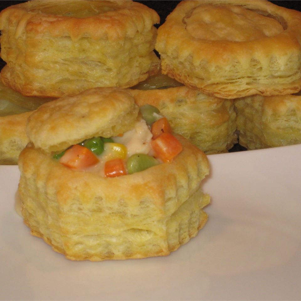 Turkey and vegetable cream sauce in puff pastry bowl