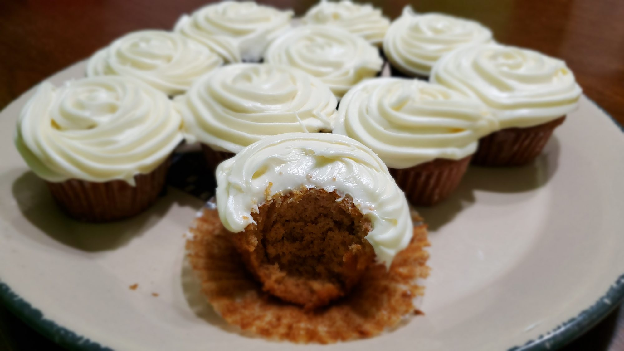 Cupcakes with white icing on white plate