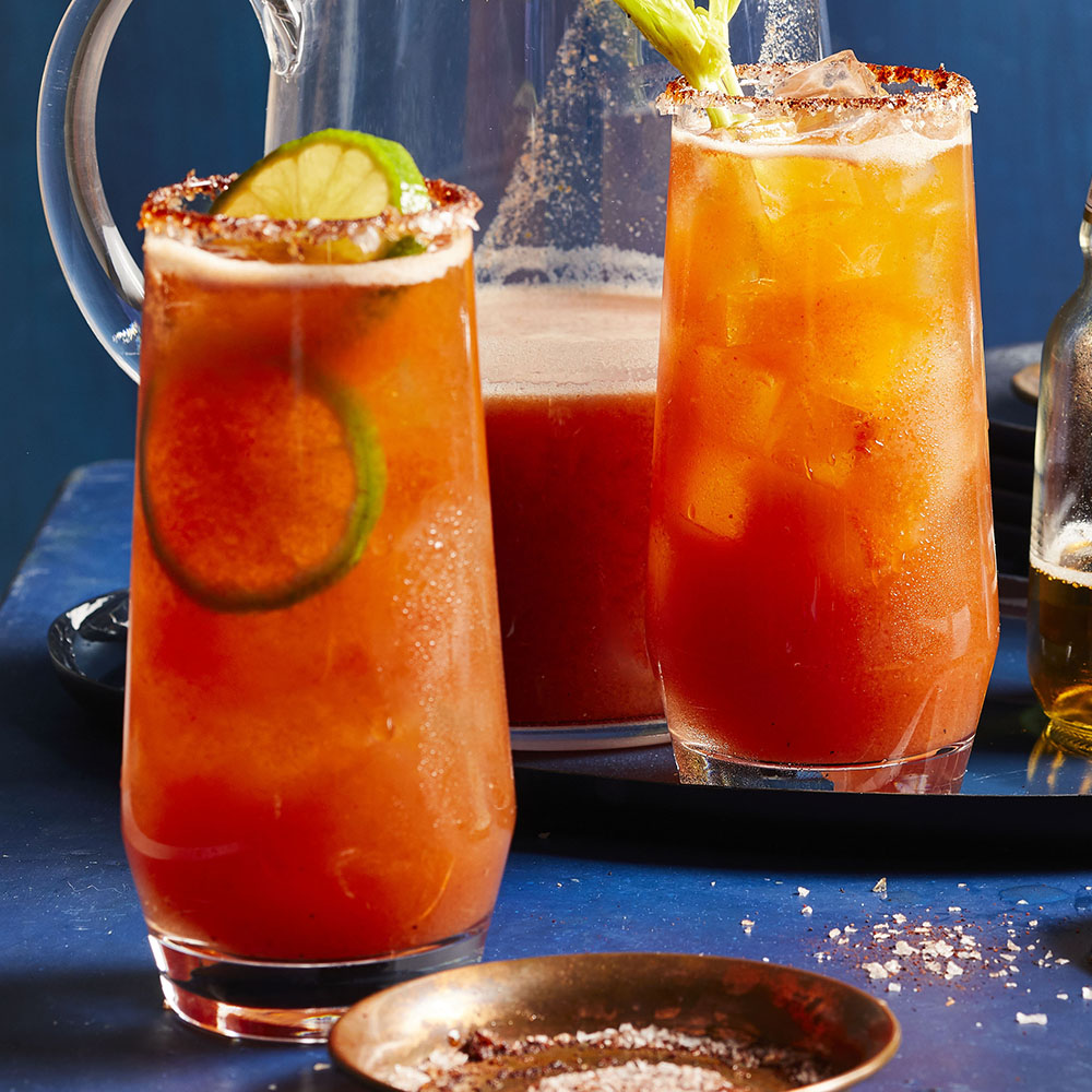 two glasses and a pitcher of Chef John's Sunset Michelada