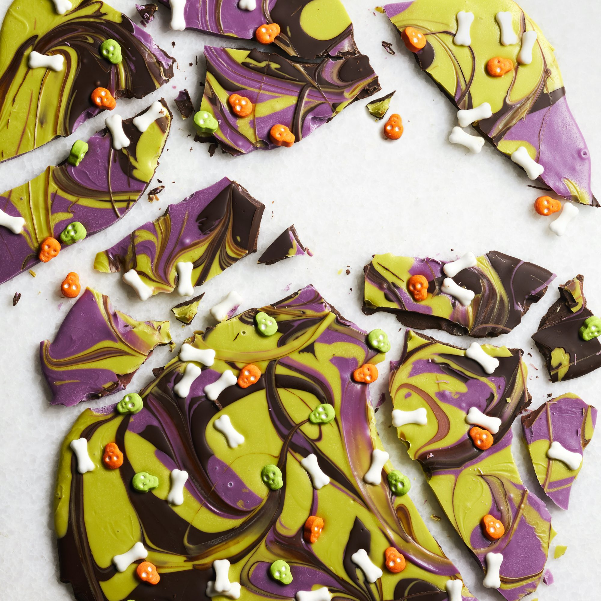 pieces of Halloween Bark with bone and skull sprinkles
