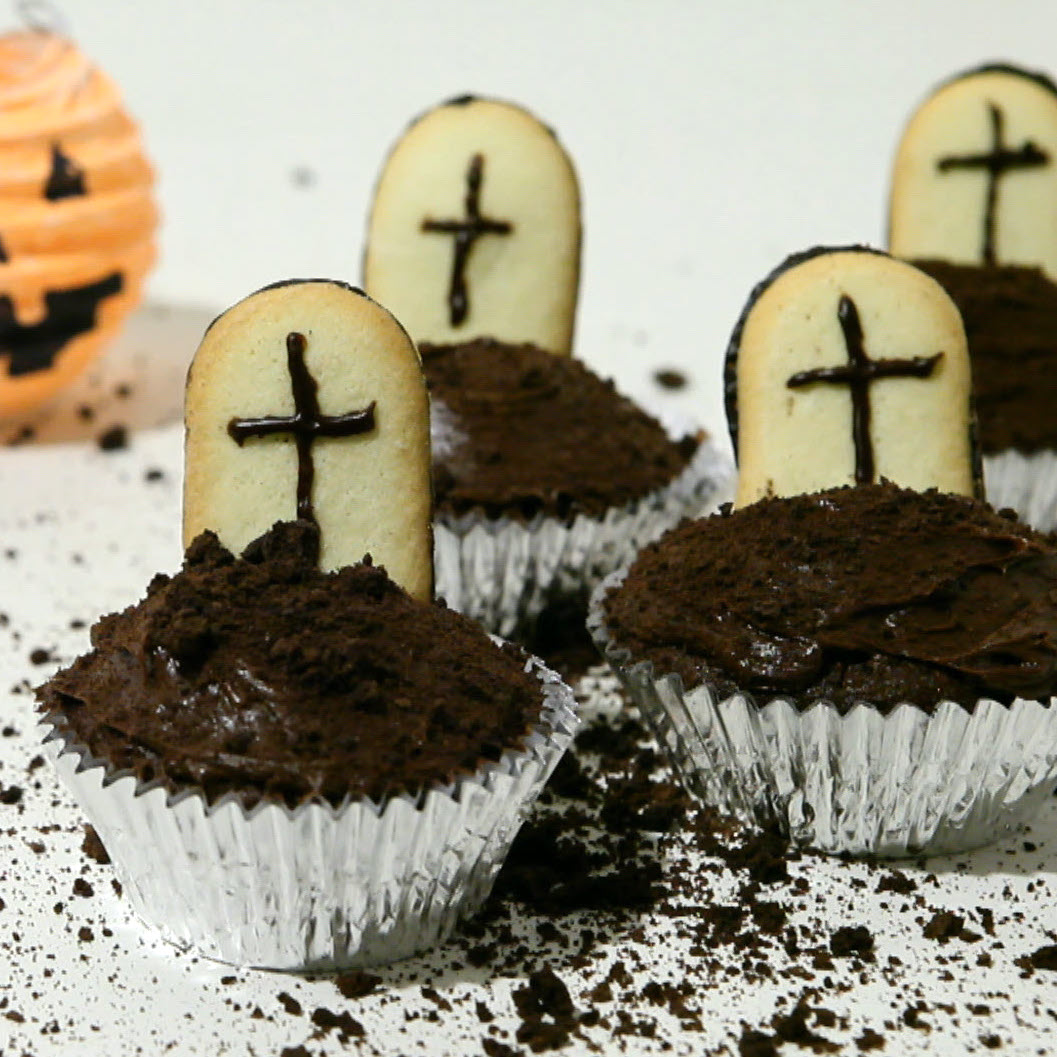 chocolate cupcakes with Milano cookie tombstones on top