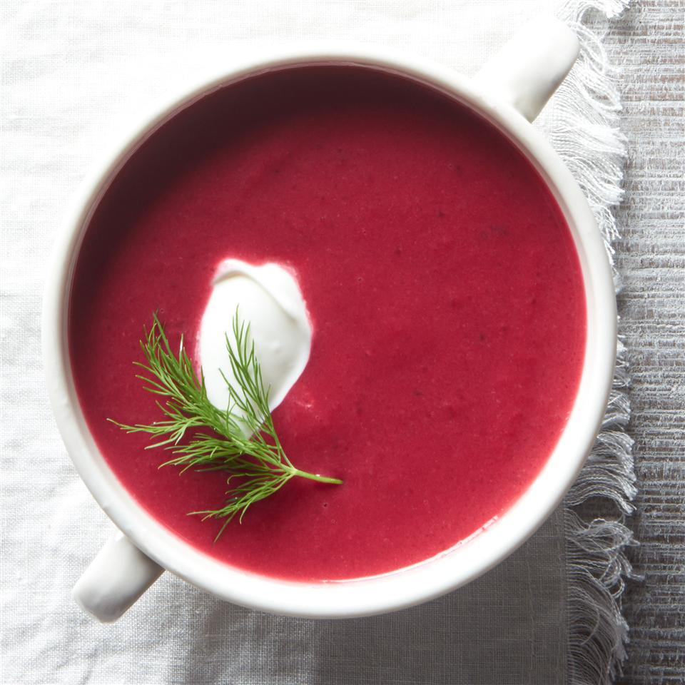 beet soup in a while mug bowl