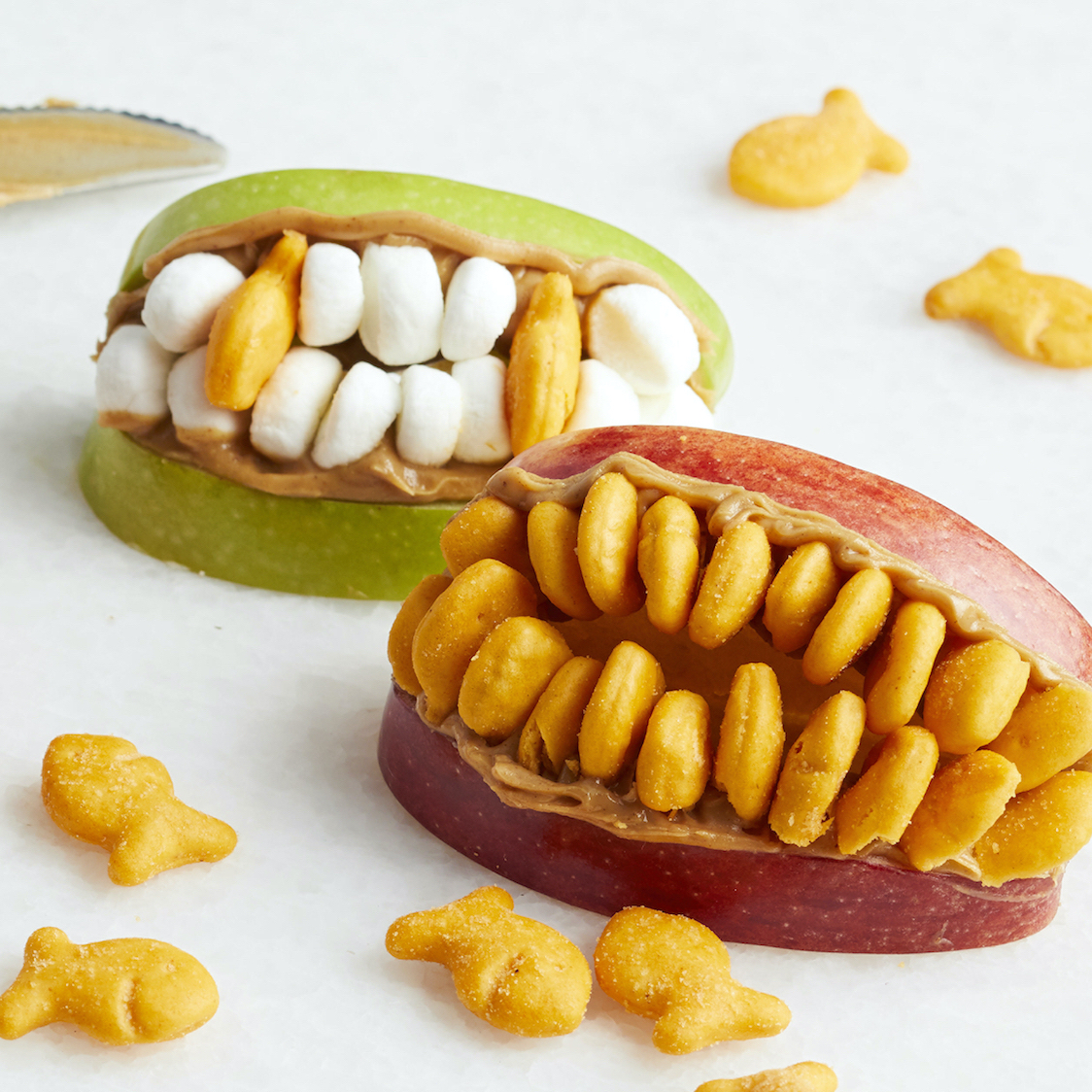 """apples with cheese crackers, almonds, and marshmallows to make """"zombie teeth"""""""