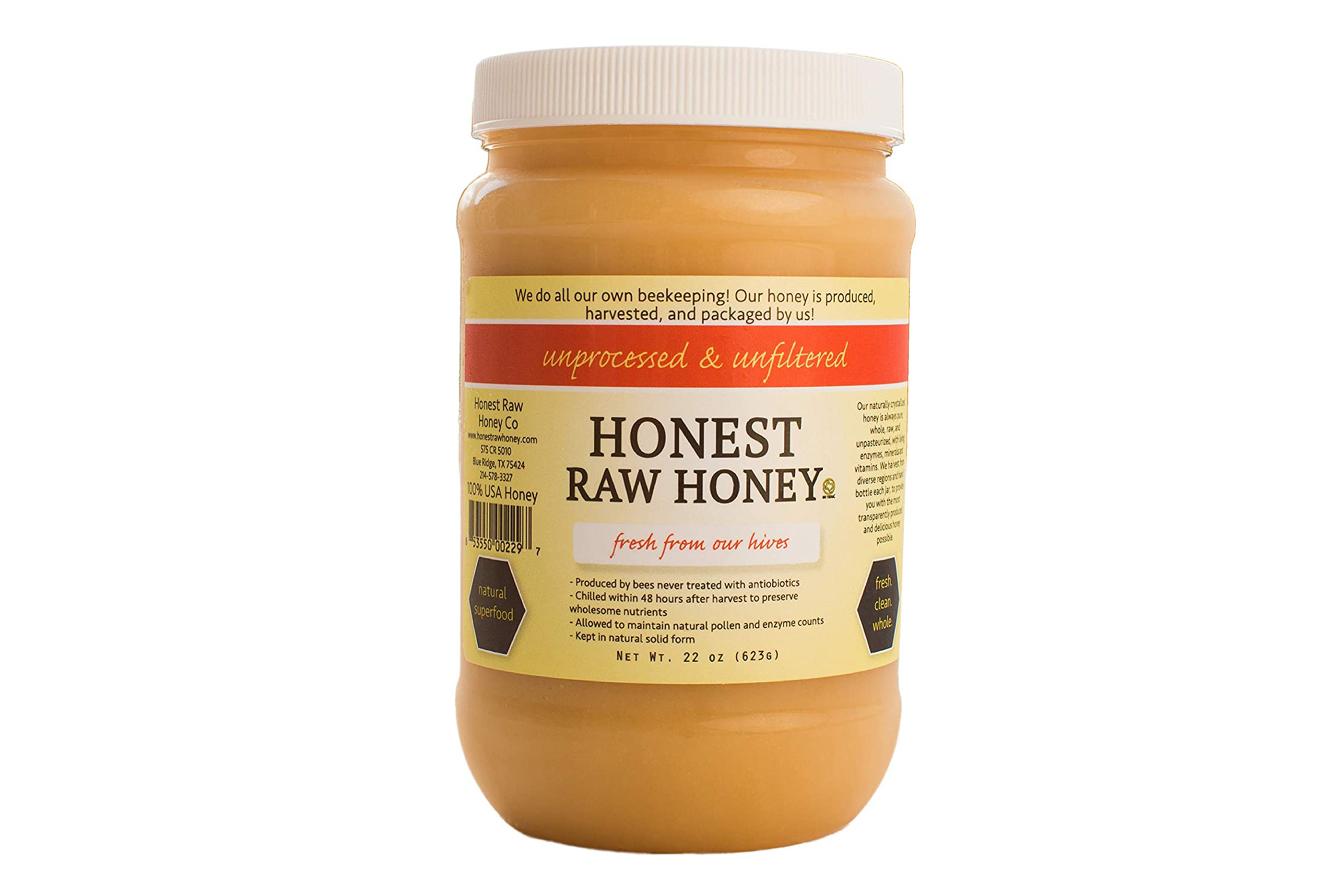 a jar of Honest Raw Honey on a white background
