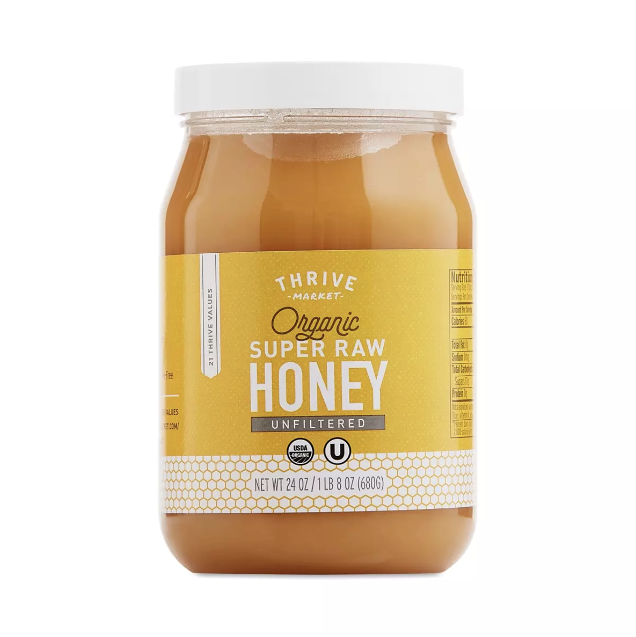 Thrive Market Organic Raw Unstrained Honey on a white background