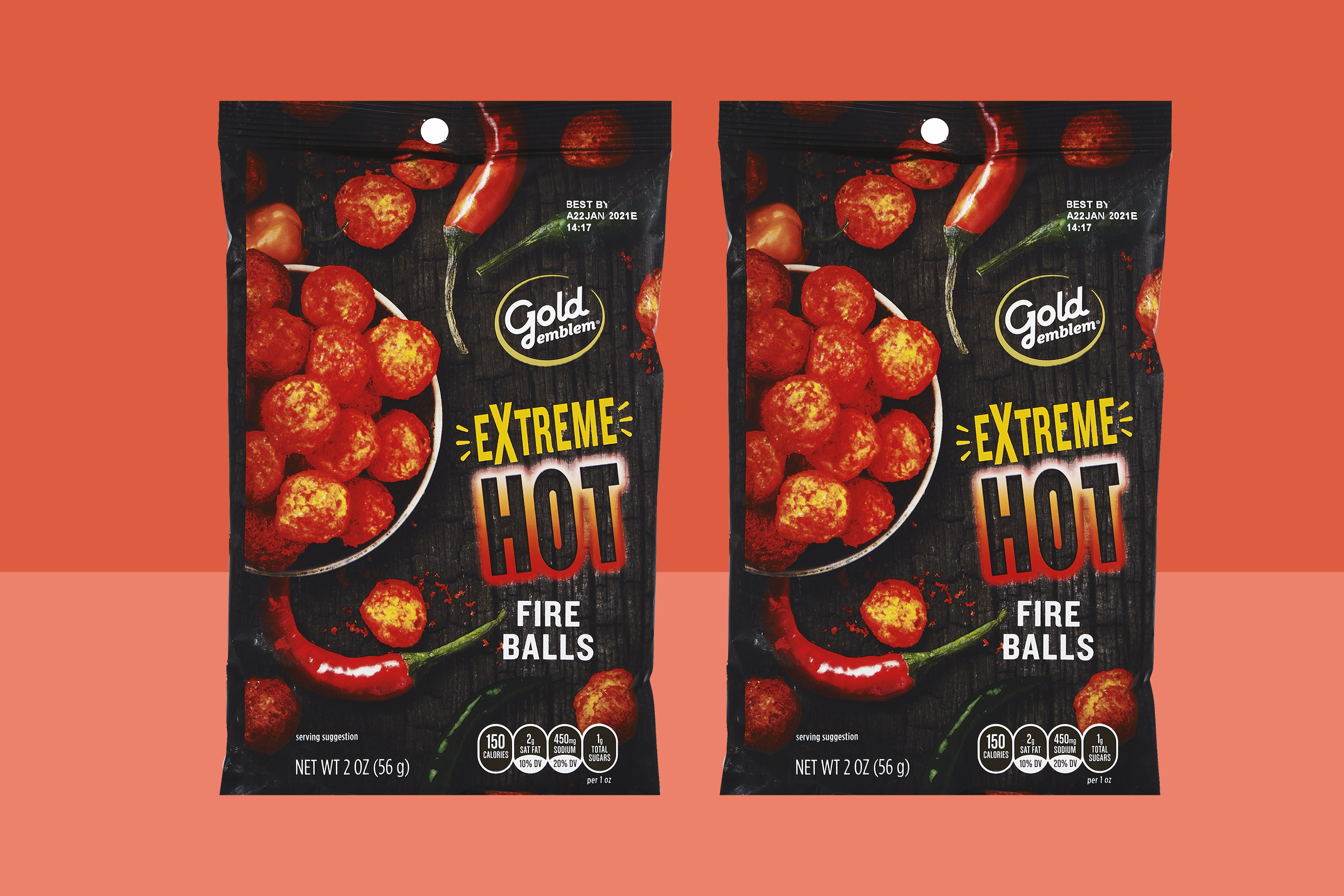 two bags of Gold Emblem Extreme Hot Fire Balls, 2 OZ on a two-tone orange background