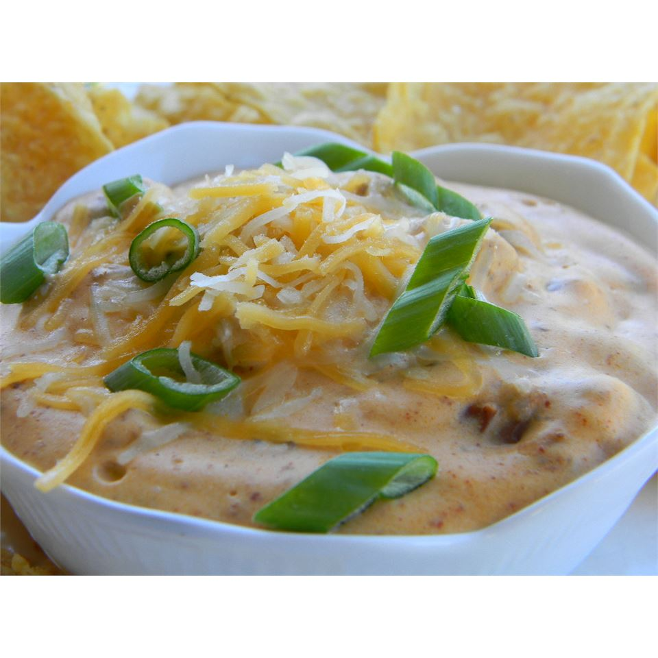 chili dip with scallions and shredded cheese