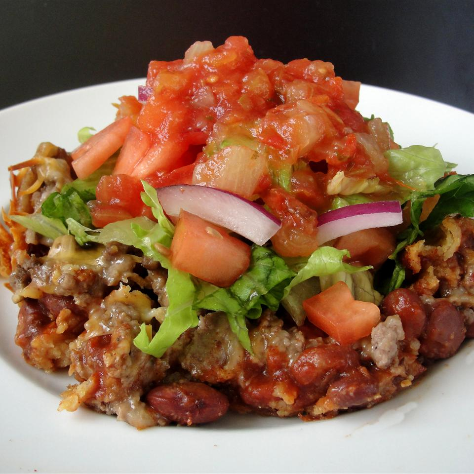 Taco casserole with diced tomatoes on top