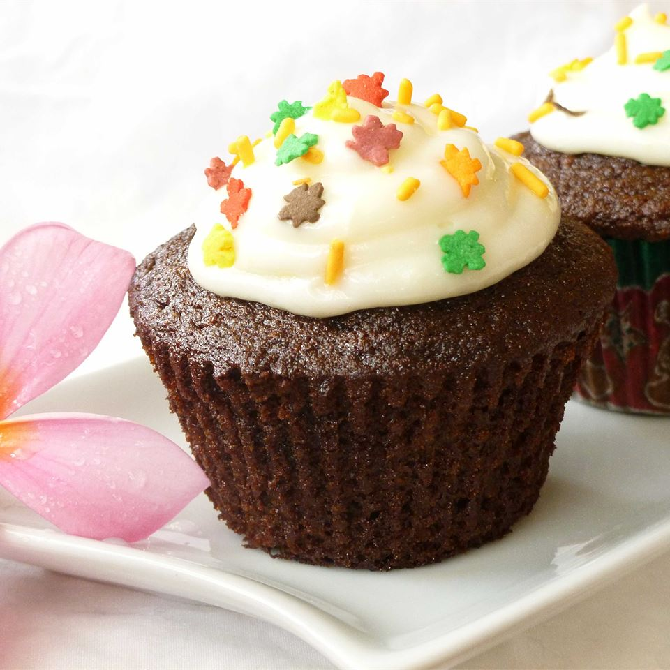 Gingerbread cupcake with cream cheese frosting and fall-themed sprinkles