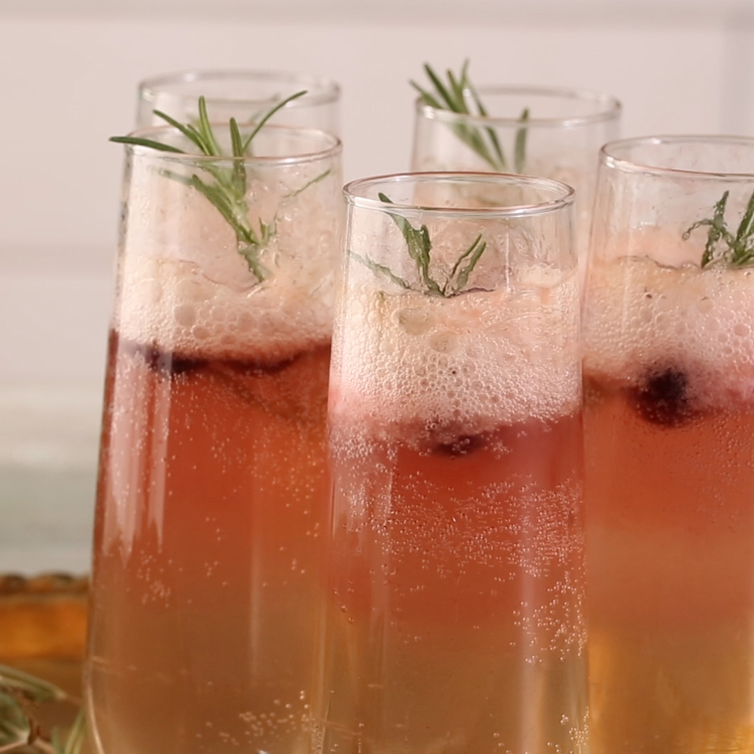 Cranberry-Rosemary Prosecco Float in champagne glasses
