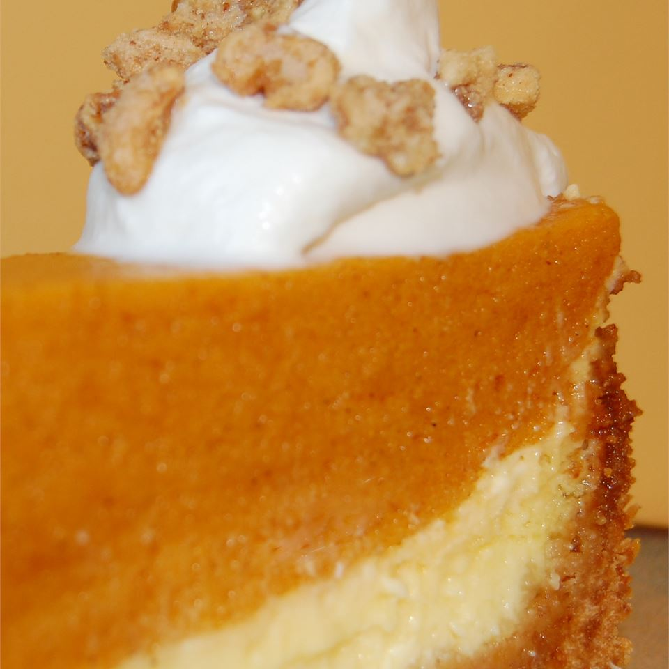 pumpkin torte with whipped cream and nut topping
