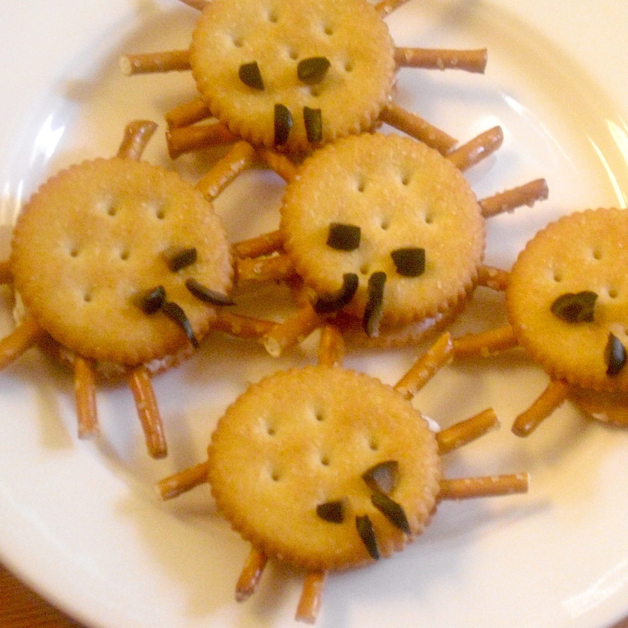round crackers with pretzels for spider legs
