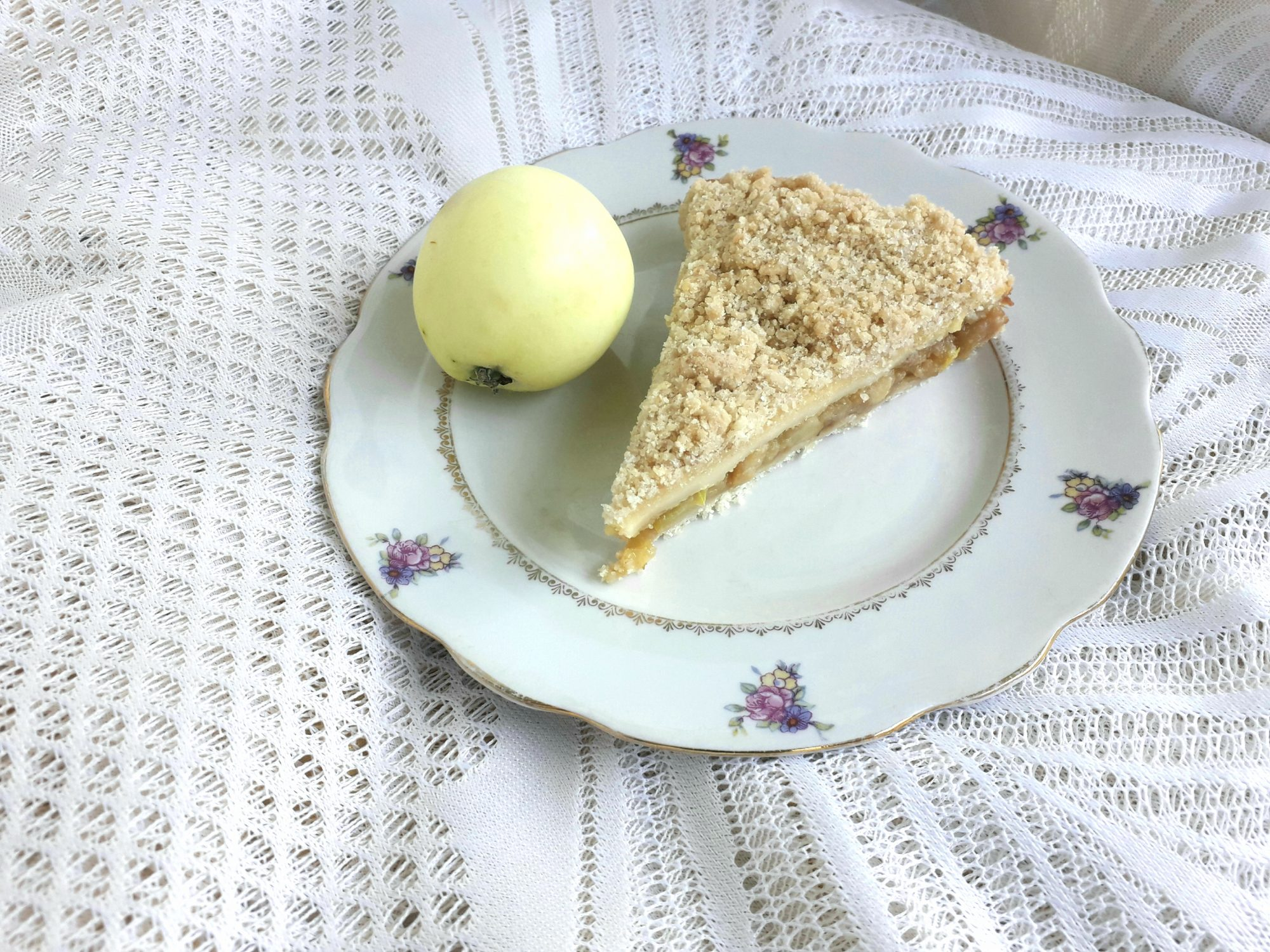 Apple buttermilk pie on white china plate