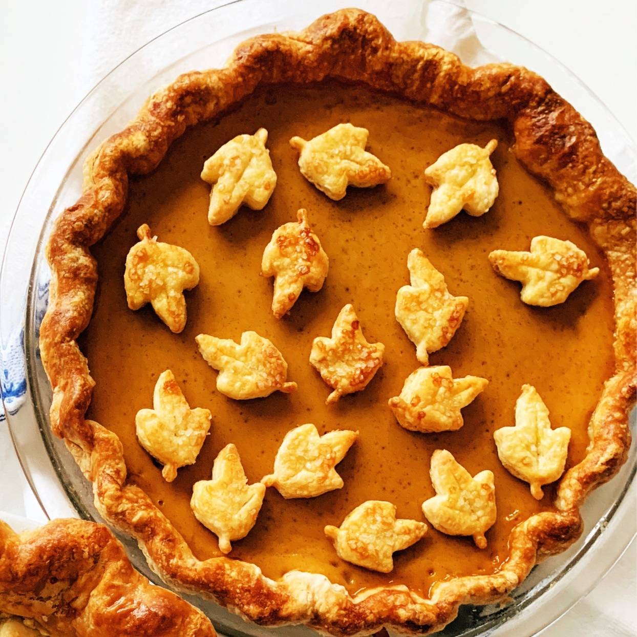 pumpkin pie with pastry leaf cutouts on top