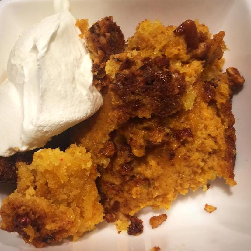 """Yellow cake mix, butter, and pecans top this cake and take credit for its signature crunch. """"Make sure you cook it long enough so the pumpkin layer sets up and the top layer gets cooked through so it has some crunch,"""" Kelly McNamara says."""