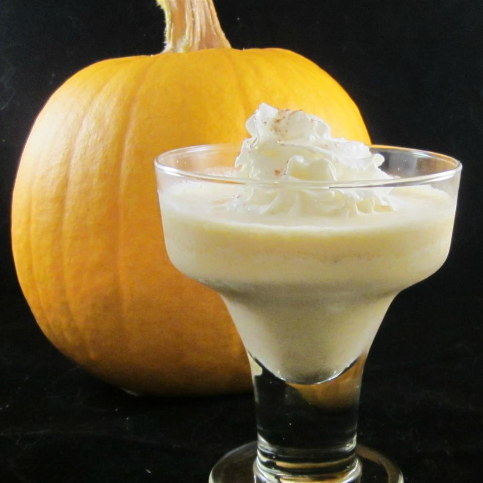 Pumpkin Pie Cocktail with a pumpkin in the background