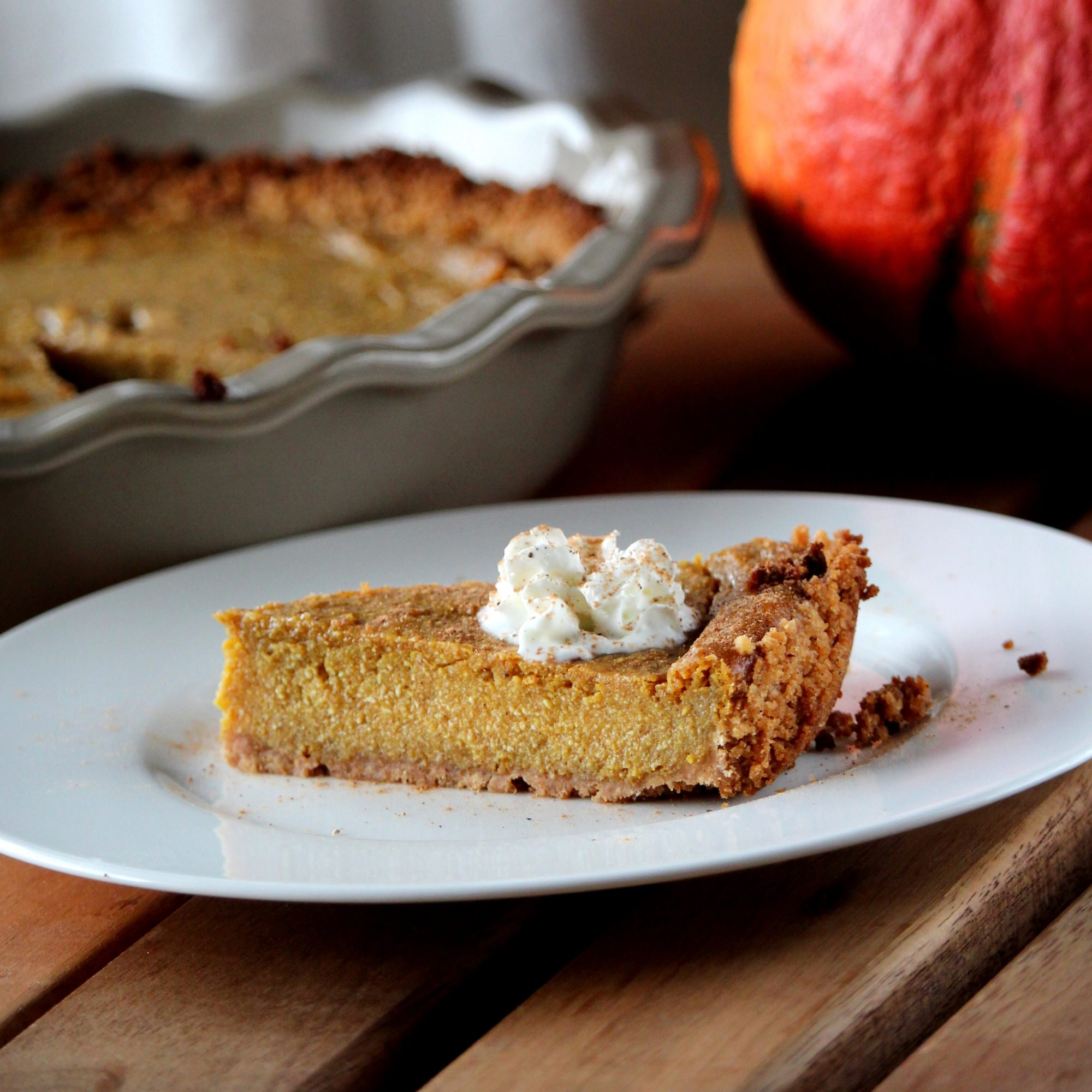 slice of pumpkin pie with whipped topping