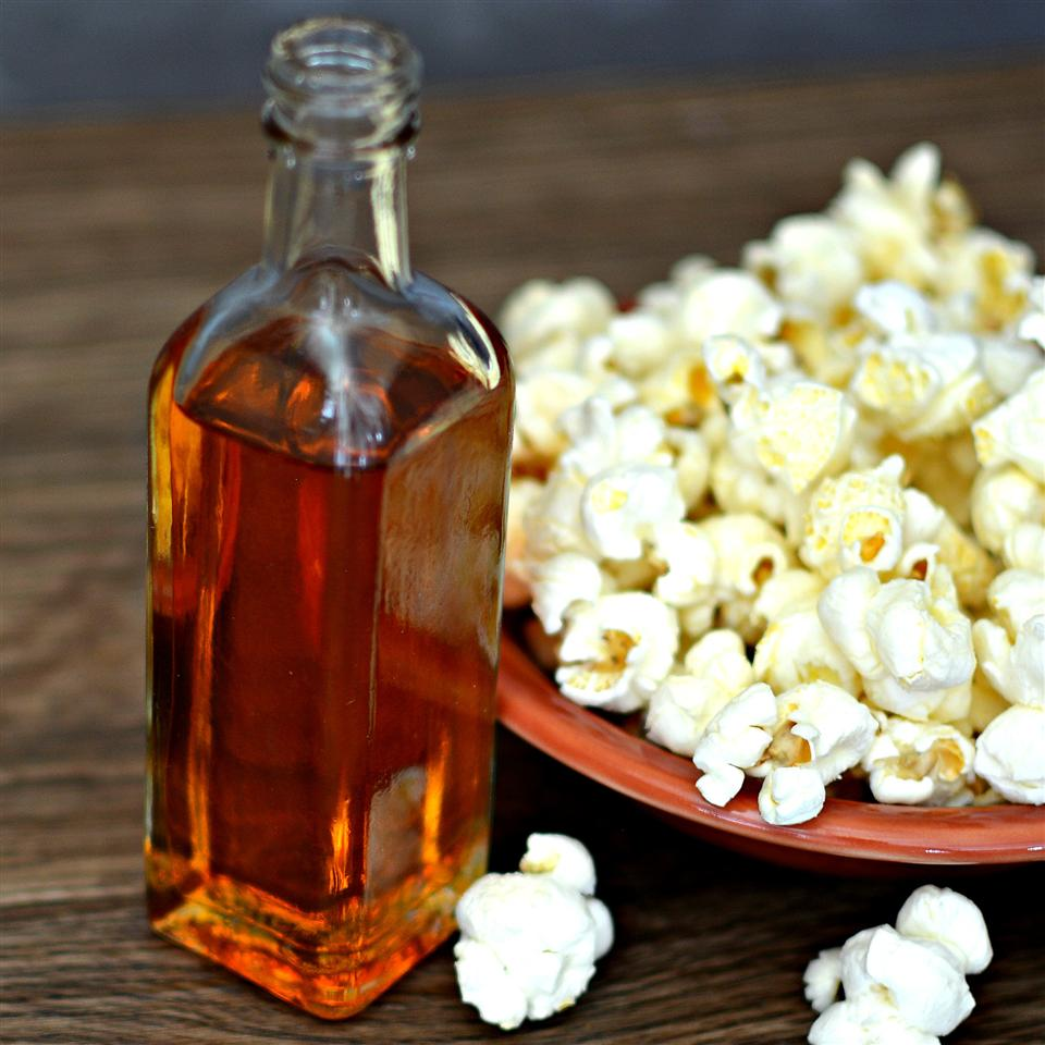 bottle of homemade chipotle oil and bowl of popcorn