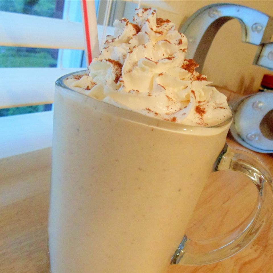 Quick and Easy Pumpkin Pie Milkshake in a mug with whipped cream