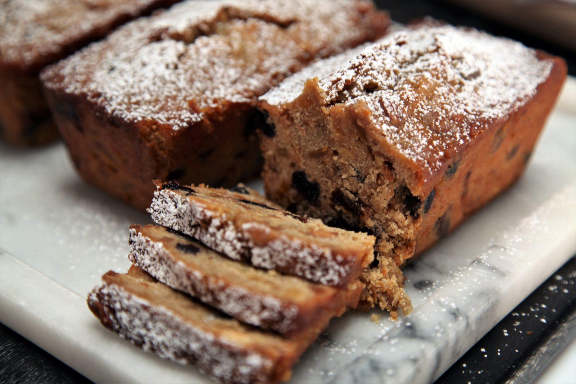 mini loaves of fruit cake dusted with confectioners sugar