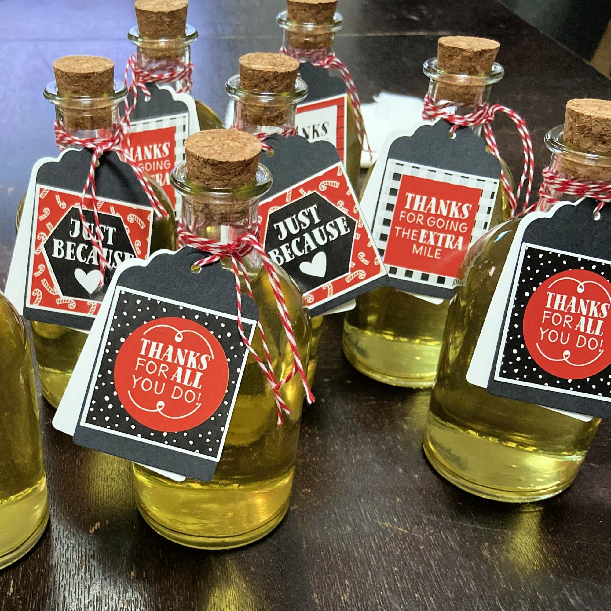 bottles of homemade limoncello liqueur with gift tags