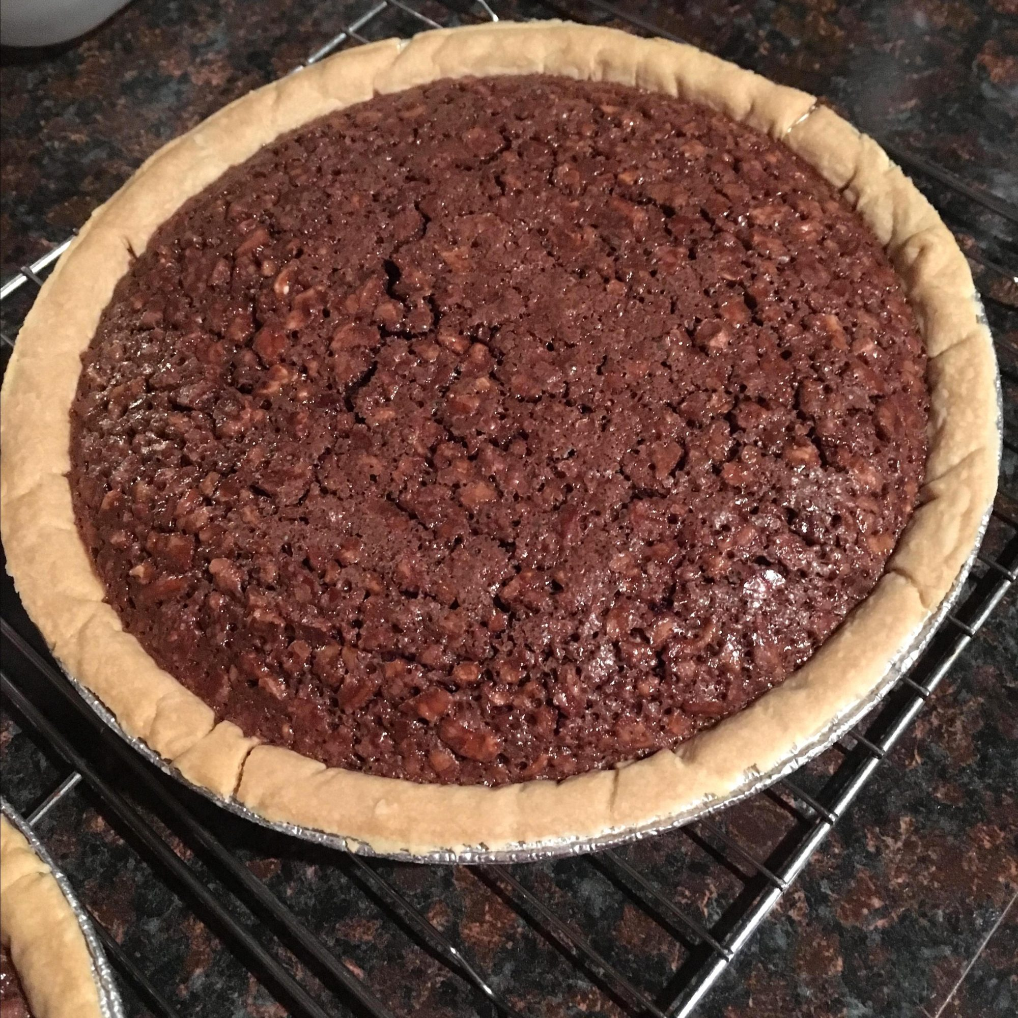 """""""I never had Fudge Pie until I moved to Tennessee. A friend from church gave me this exact same recipe. I did have a deep-dish pie shell, and so I scaled the servings to 12, and it worked wonderfully! My husband and I loved it. This is going in the old recipe file to hand down to my daughters!"""" — srevels"""