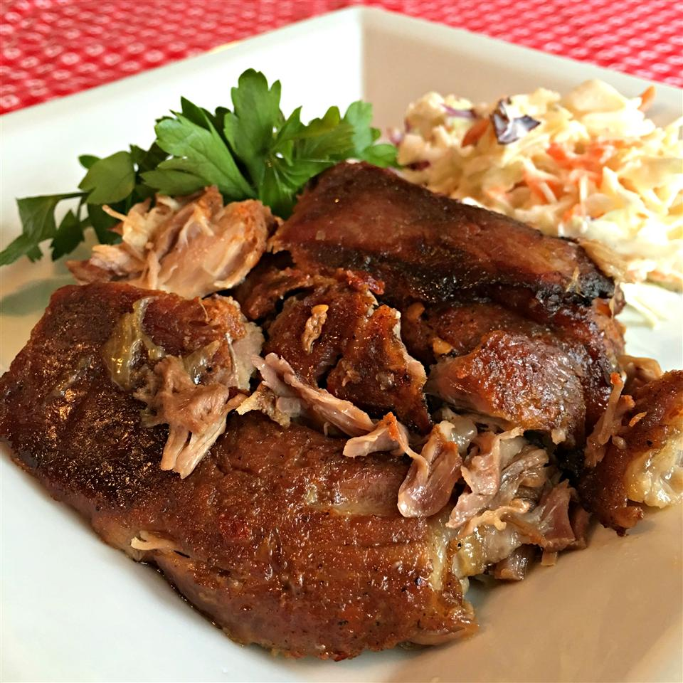 Sweet and Spicy Ginger Beer Pulled Pork on a white plate