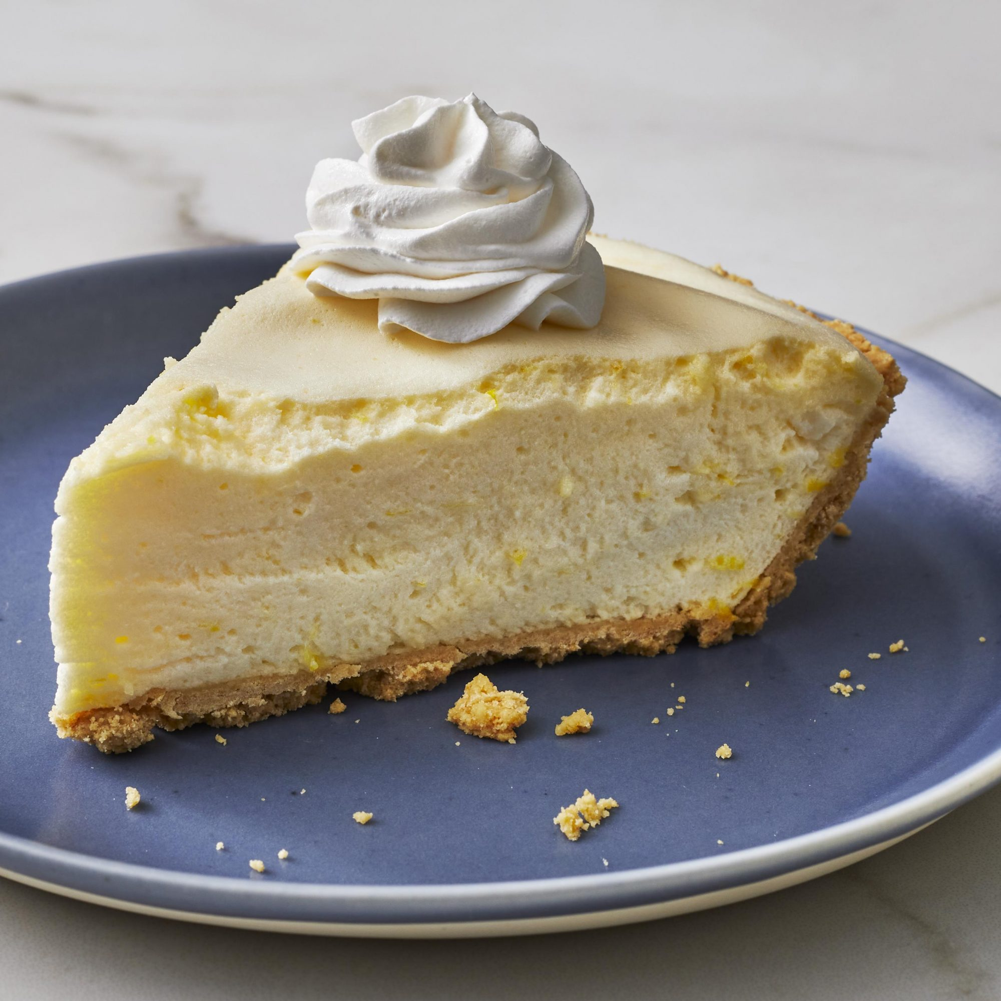 Slice of lemon chiffon pie with whipped cream