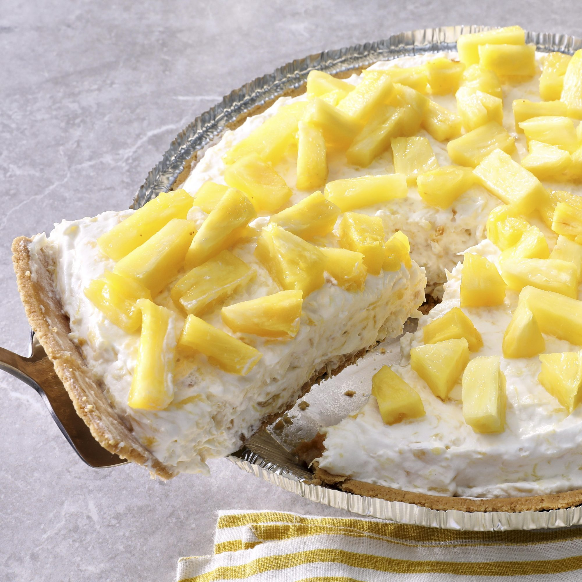 Pineapple cheesecake with slice removed