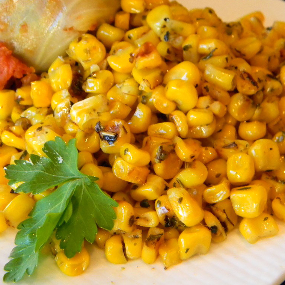 corn side dish on a white plate
