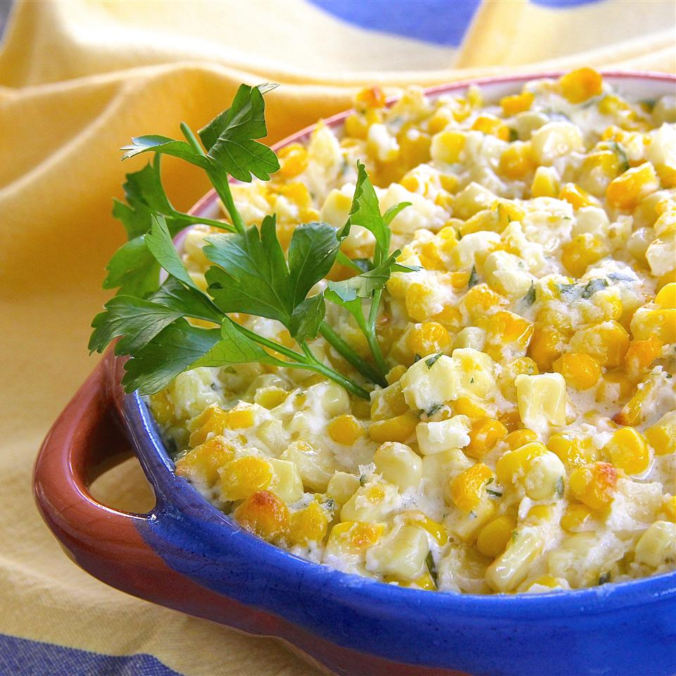 corn with parsley garnish in a blue bowl