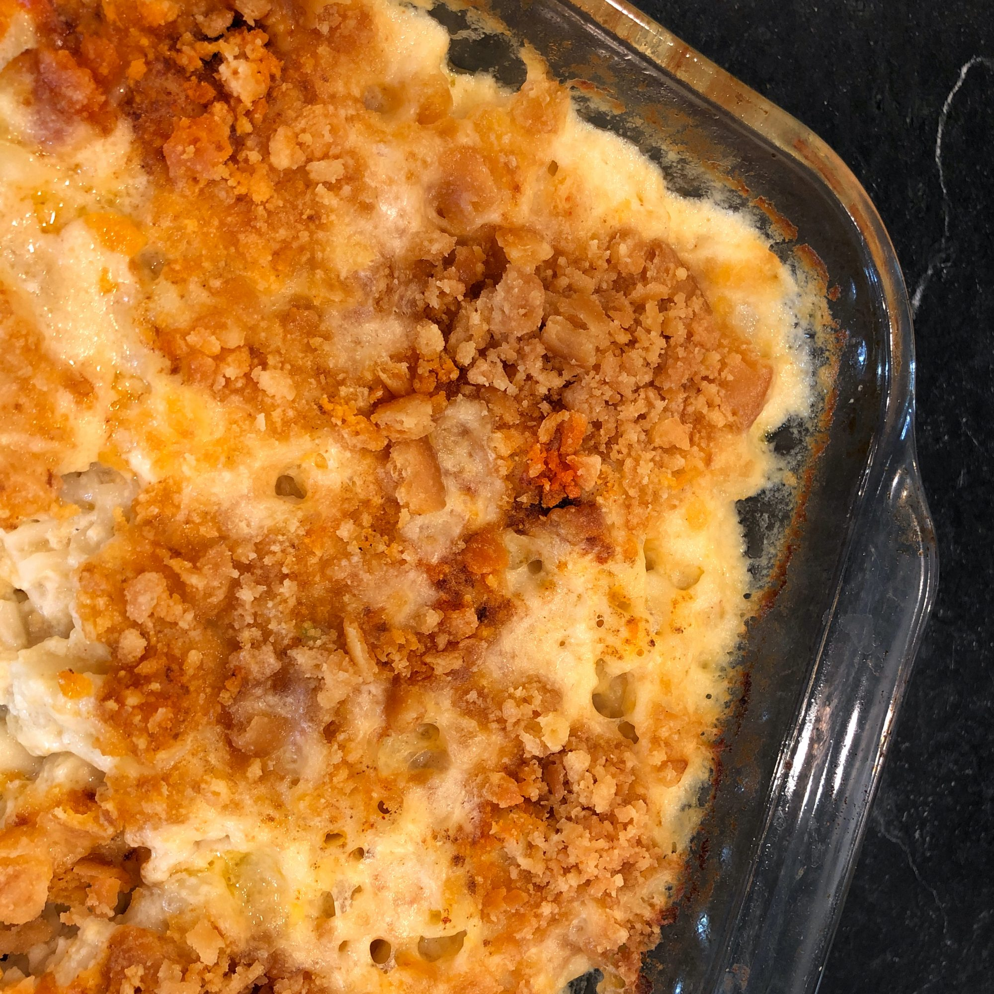 mac and cheese in a glass pan