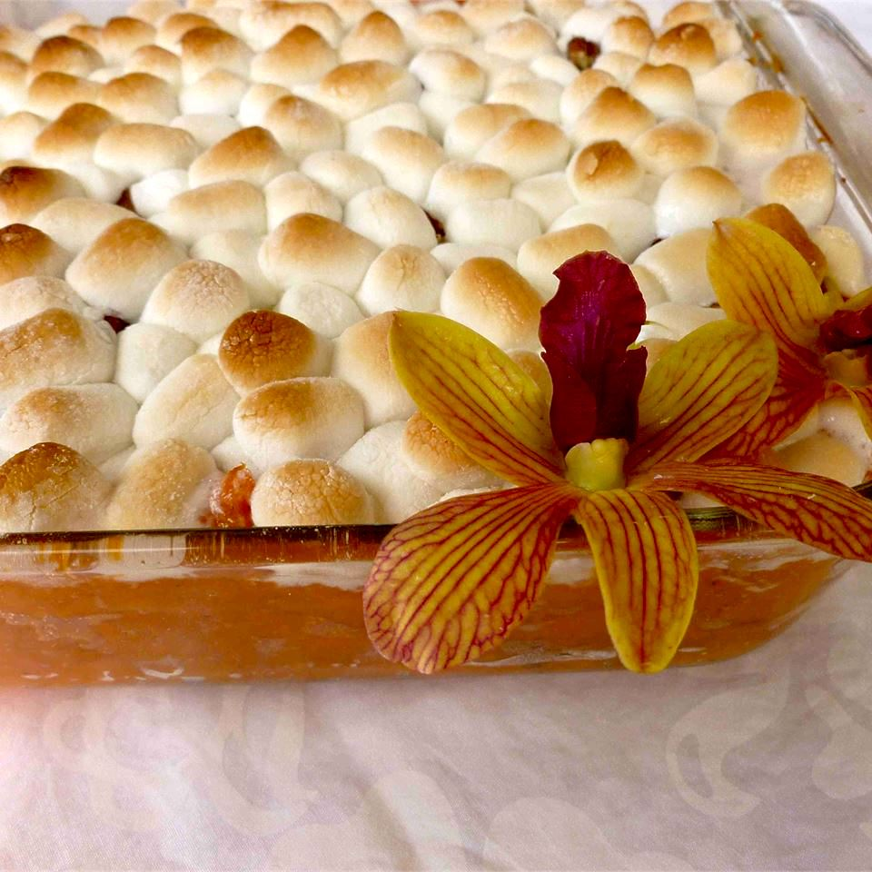 sweet potato casserole with marshmallows in a glass dish