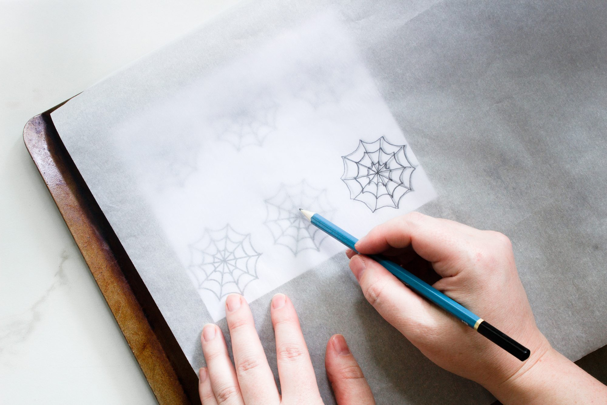tracing spiderwebs on parchment paper