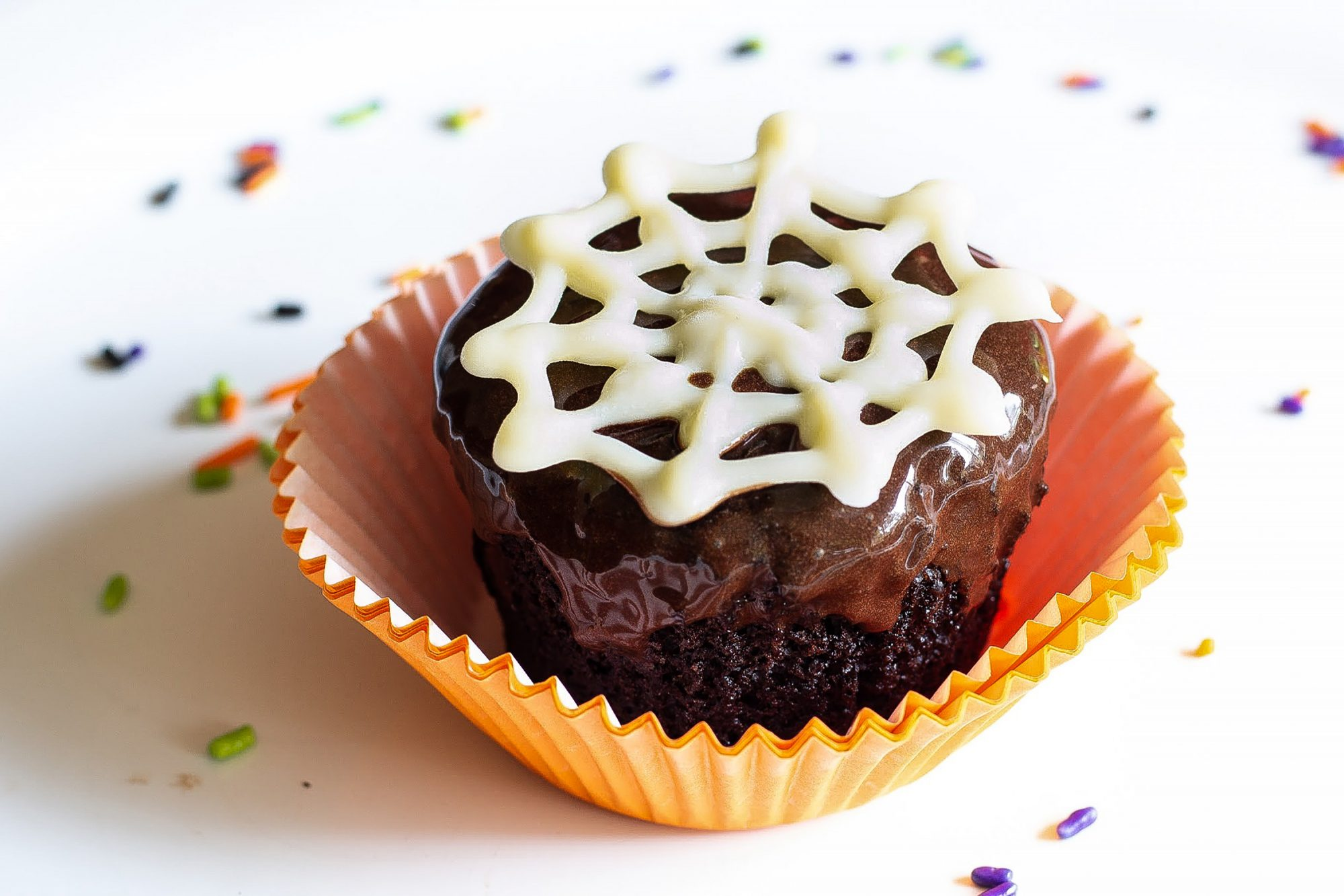 Chocolate Cupcake with Chocolate Frosting, Orange Wrapper and White Chocolate Spider Web