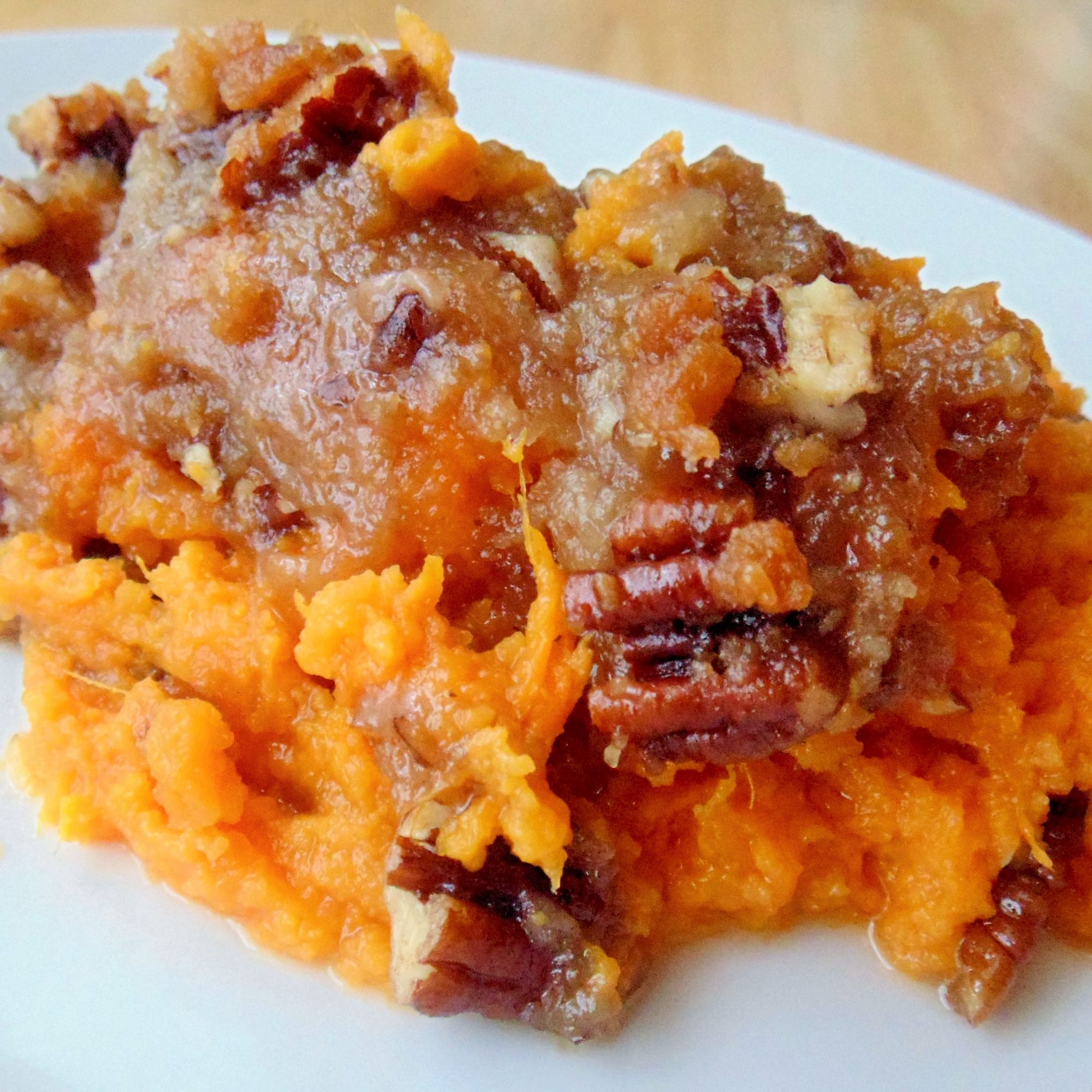 serving of sweet potato casserole with pecan streusel topping