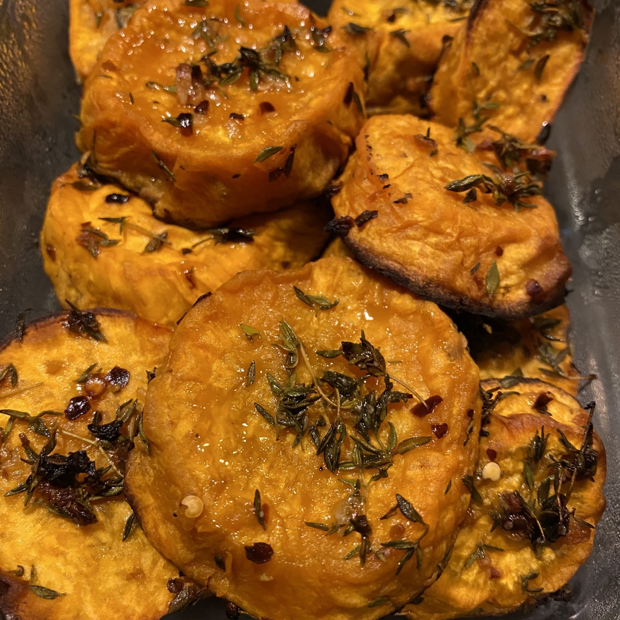 sliced sweet potatoes with thyme