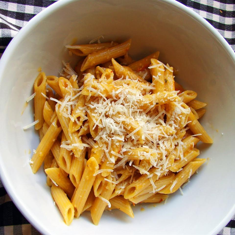 Cherry Tomato Sauce with Penne in a white bowl on a black and white gingham table cloth