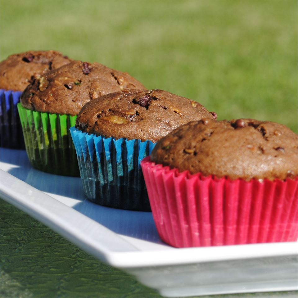 Chocolate Zucchini Muffins in colorfull wrappers