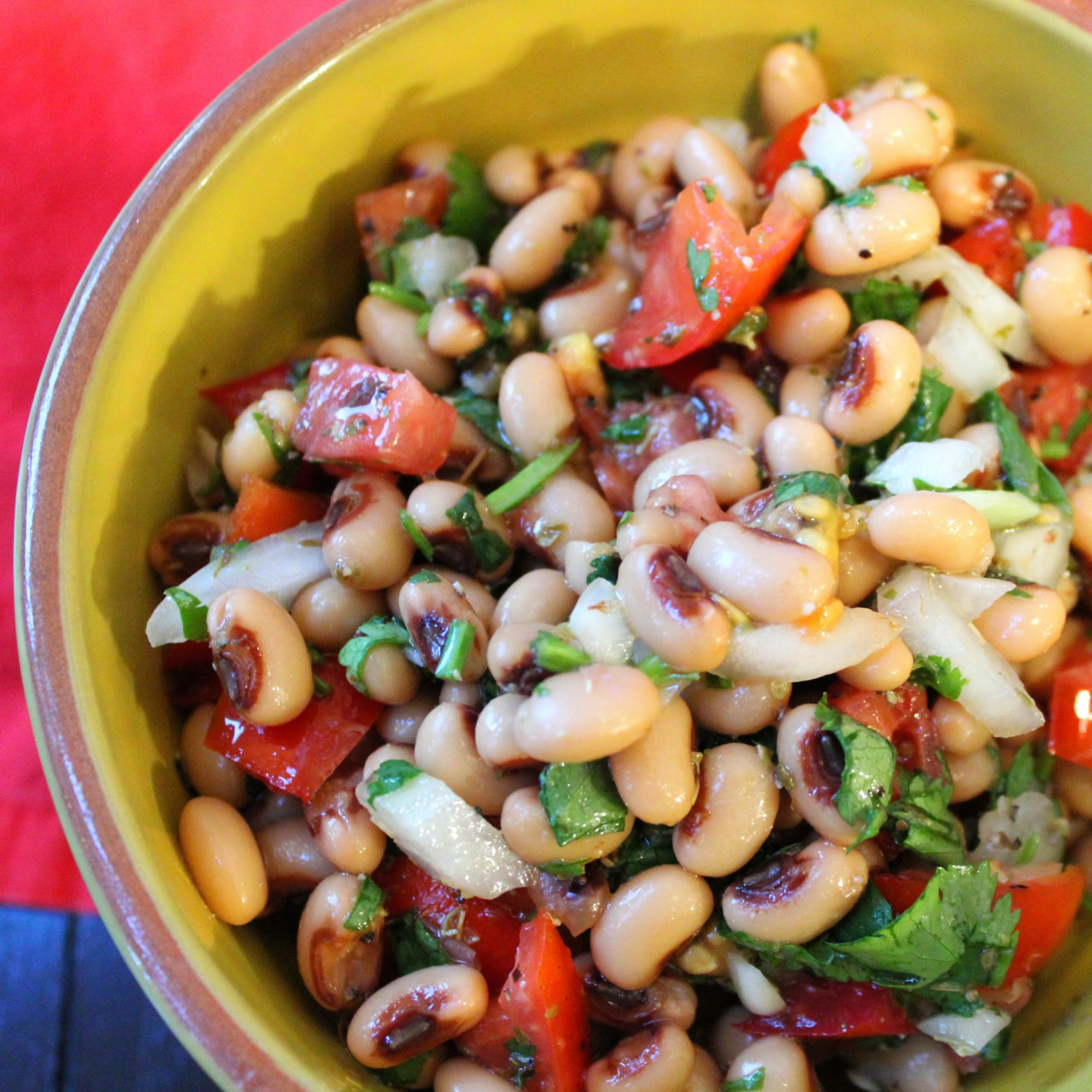 Vegan Black Eyed Pea Salad with Cilantro in a yellow bowl
