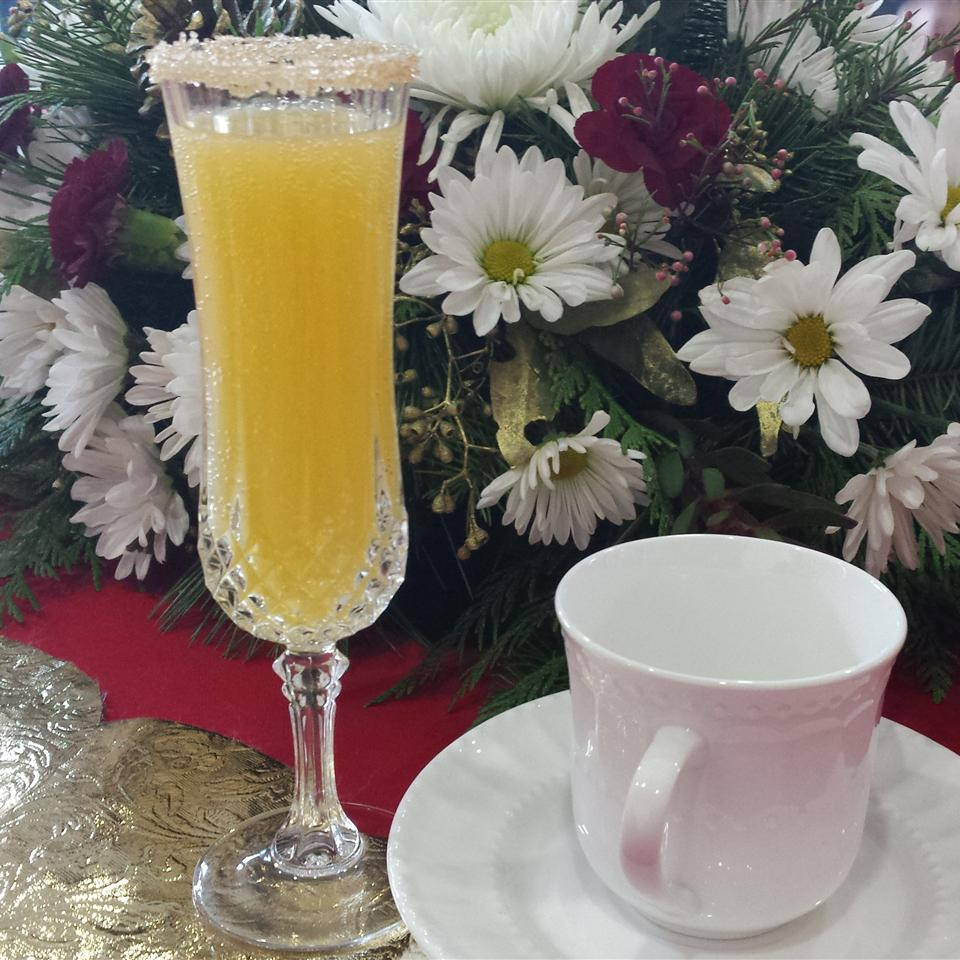 Holiday Mimosa with sugar on the glass rim
