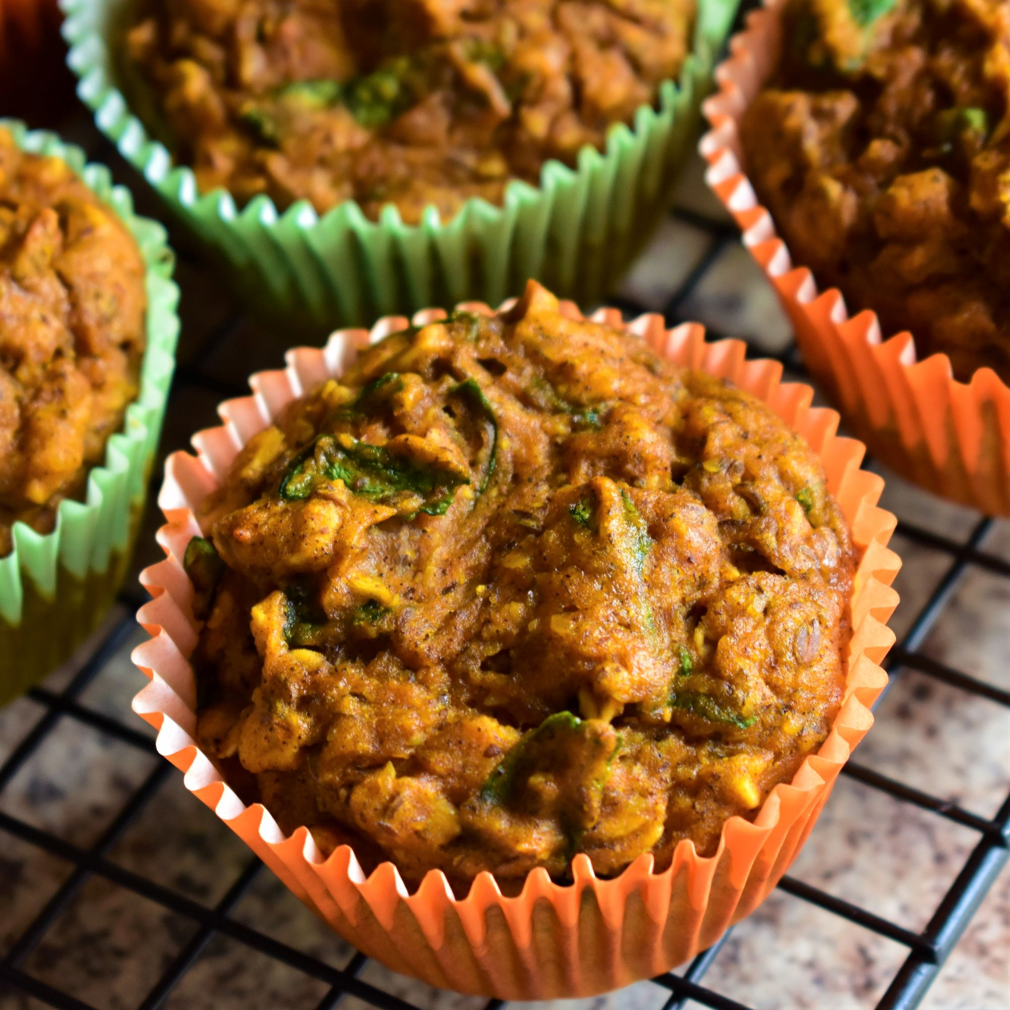 pumpkin spinach muffins on a cooling rack