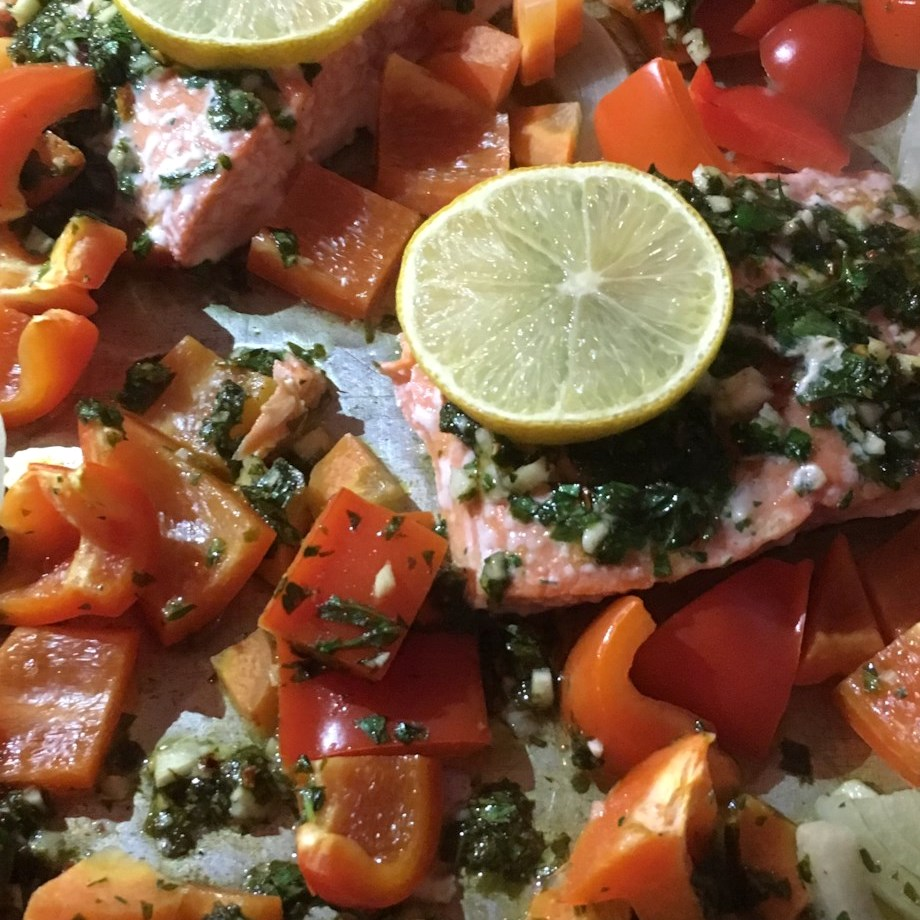 salmon and bell peppers on a sheet plan