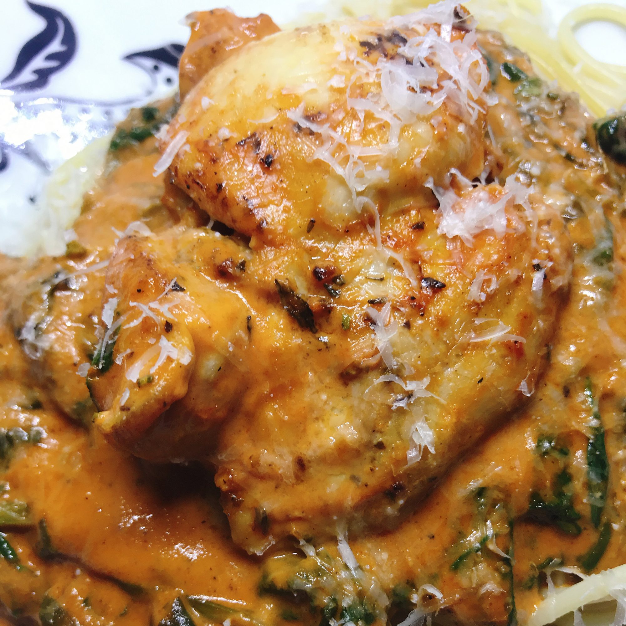 Italian Pan-Fried Chicken Thighs with Creamy Tomato Sauce over pasta
