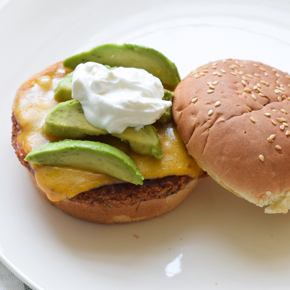 Mexican Bean Burgers with sour cream and avocado